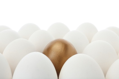 Golden egg among ordinary ones on white background, closeup