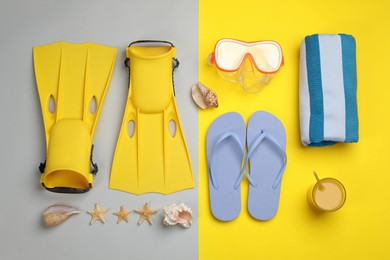Flat lay composition with beach objects on color background