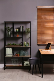 Stylish room with shelving and table. Interior design