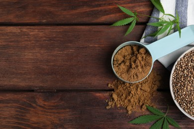 Hemp protein powder, seeds and fresh leaves on wooden table, flat lay. Space for text