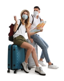 Couple in face masks with map on white background. Summer travel