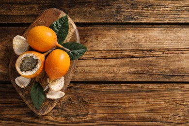 Delicious ripe granadillas on wooden table, top view. Space for text