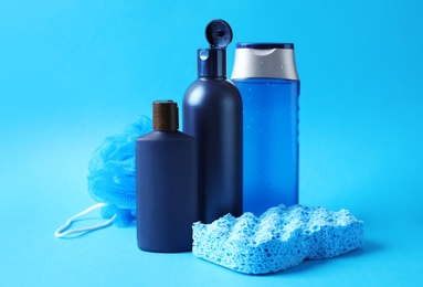 Set of different men's cosmetic products on light blue background