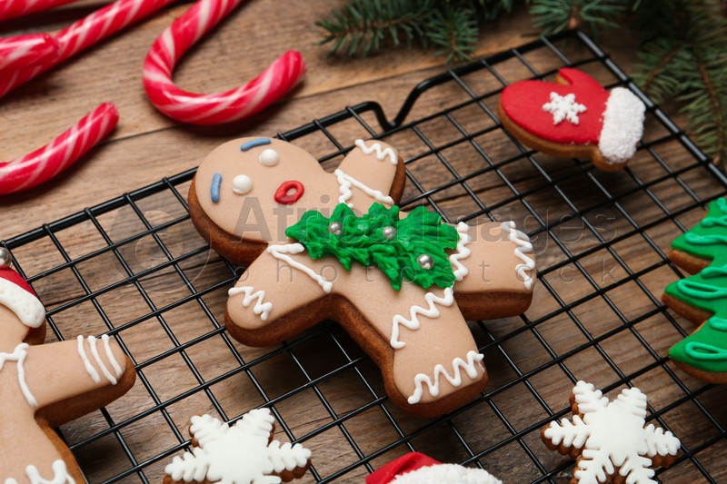 Delicious Christmas cookies and candies on wooden table, closeup