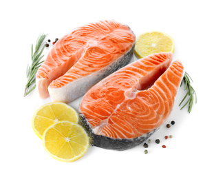 Fresh raw salmon with lemon, pepper and rosemary on white background. Fish delicacy