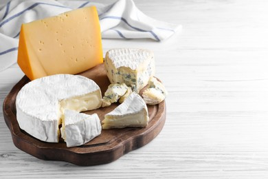 Fresh dairy products on white wooden table, space for text