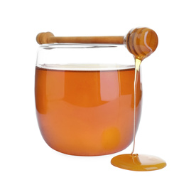 Glass jar of wildflower honey and wooden dipper isolated on white