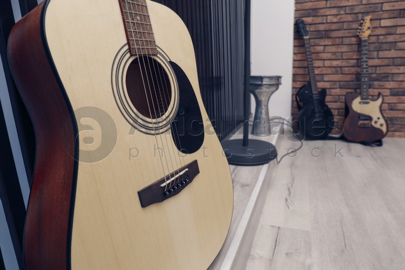 Different musical instruments indoors, focus on classical guitar