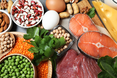 Products rich in protein on table, flat lay
