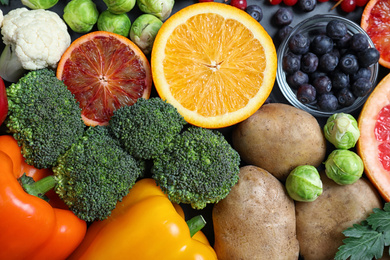Different products rich in vitamin C on table, top view