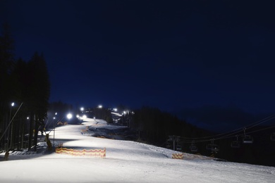 Beautiful landscape with ski track at night. Winter vacation