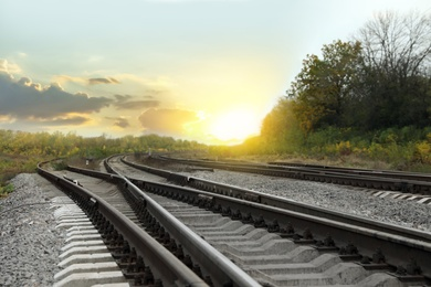 Railway lines with track ballast in countryside. Train journey