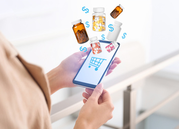 Woman with smartphone ordering medications online indoors, closeup