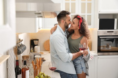 Lovely couple enjoying time together during romantic dinner in kitchen