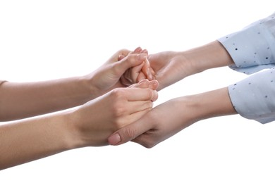 Women holding hands on white background, closeup