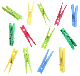 Set with bright plastic clothespins on white background