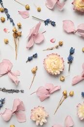 Flat lay composition with beautiful dried flowers on light background
