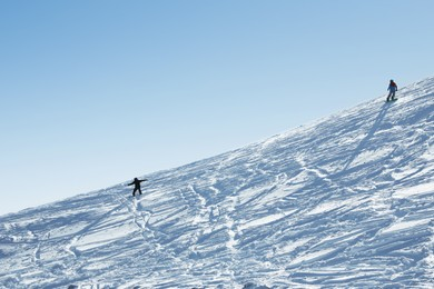 Male skiers on slope at resort. Winter vacation