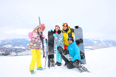 Group of friends taking selfie at mountain resort. Winter vacation