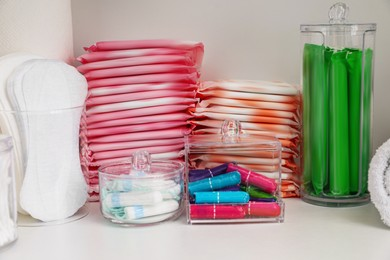 Storage of different feminine hygiene products in cabinet