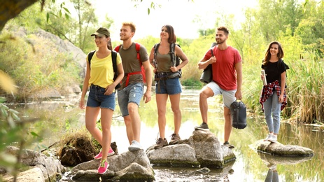Group of friends hiking outdoors. Camping vacation