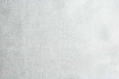 Texture of delicate white fabric as background, closeup