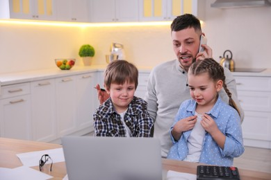 Multitasking man combining parenting and work at home