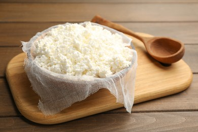 Delicious fresh cottage cheese on wooden table