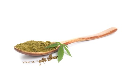 Wooden spoon with hemp protein powder and fresh leaf on white background