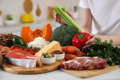 Woman and healthy food at white table, closeup. Keto diet