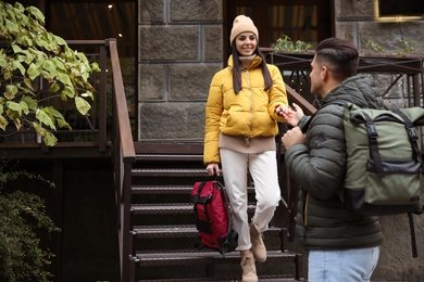 Couple with travel backpacks outdoors. Urban trip