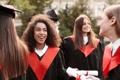 Group of happy students outdoors. Graduation ceremony