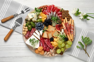 Different tasty appetizers on white wooden table, flat lay