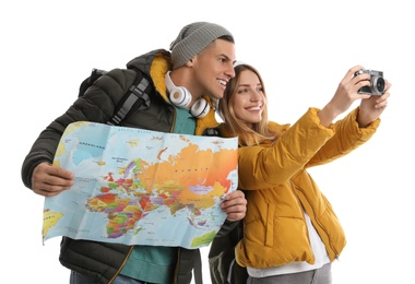 Couple with map and camera on white background. Winter travel