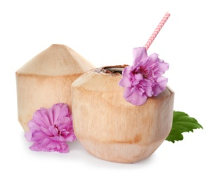 Young peeled coconuts with straw, leaf and beautiful flowers on white background
