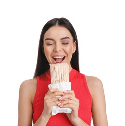 Young woman eating delicious shawarma on white background