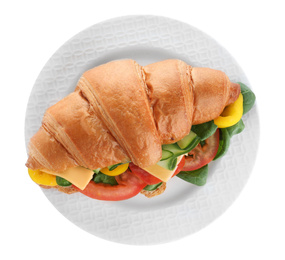 Plate with tasty vegetarian croissant sandwich isolated on white, top view