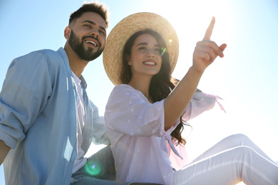 Happy young couple outdoors on sunny day. Honeymoon trip