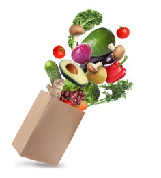 Paper bag with vegetables and fruits on white background. Vegetarian food