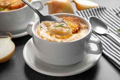 Fresh homemade french onion soup on grey table