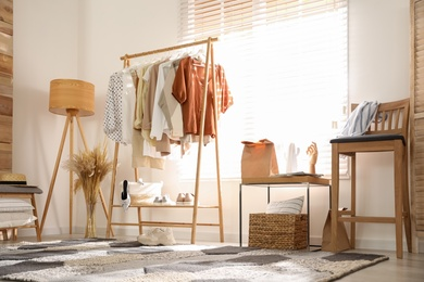 Dressing room interior with stylish wooden furniture