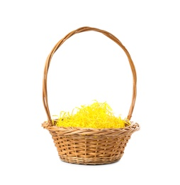 Wicker basket with yellow filler isolated on white. Easter item