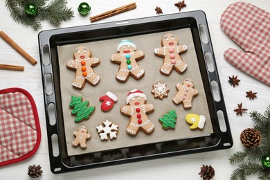 Delicious Christmas cookies and festive decor on white wooden table, flat lay