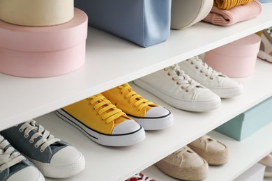 White shelving unit with collection of colorful sneakers and accessories