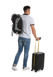 Man with suitcase and backpack for vacation trip on white background. Summer travelling