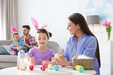 Happy family preparing for Easter holiday at home