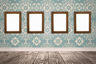 Frames with empty canvases on wall in modern art gallery. Space for design