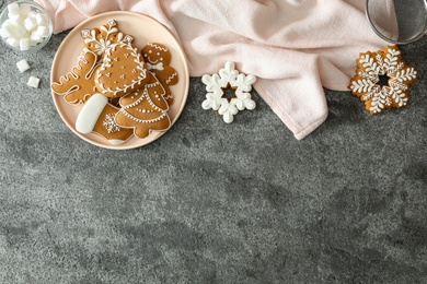 Flat lay composition with delicious homemade Christmas cookies on grey table. Space for text