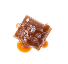Delicious salted caramel with sauce on white background, top view