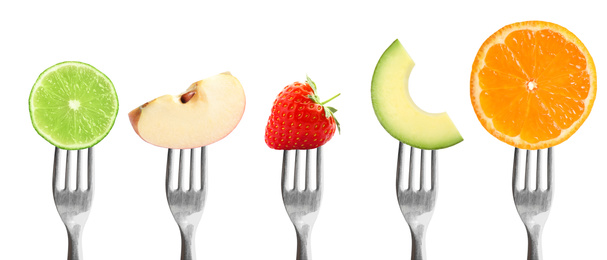 Forks with different vegetables and fruits on white background, banner design. Healthy meal